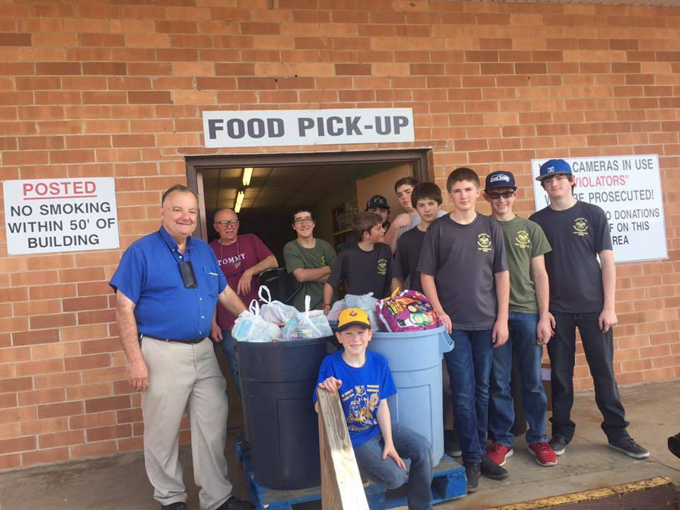 Boy Scouts Troop 60 collect 900 pounds of food for food drive