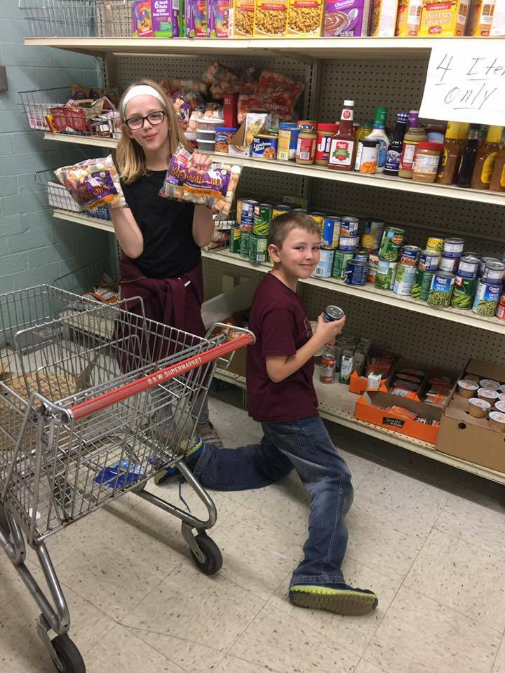 Young volunteers stocking shelves